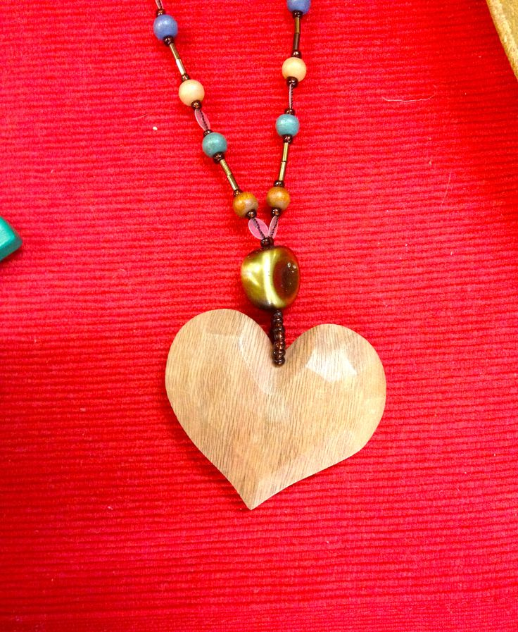 A little bit of love - timber heart necklace with blue beads....