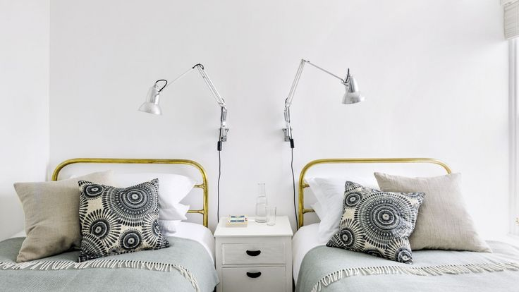 Symettry In This Small Bedroom Transforms The Room Into A Stylish Space  With A Hotel Feel