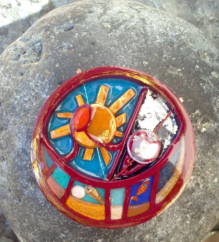 Handmade polymer clay pendant, custom made. Parts filled with liquid glass. Size: Circle's perimeter is 6cm. I am saying thank's to my client for ''filling'' the days it took me to make this,with colours sent from another country and continent......  This is the third ''partecipant'' of this work a siger ,from Portugal this time whom i realy love. Agua stants for water https://www.youtube.com/watch?v=3WFHIfMOERc