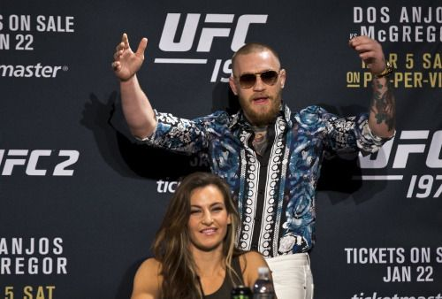 Conor McGregor dominates stage at UFC 197 news conference...