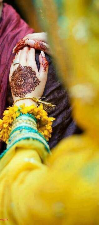 Henna/mehndi, the colour has set really well on her hand and the simplicity of the design makes it all the more beautiful!