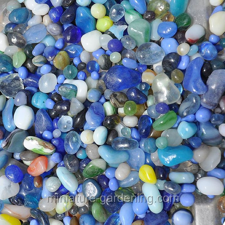 The package of Decorative Pebbles comes in an assortment of glass pebbles in tones of navy, sky blue, and aqua. Hints of cream and gray pebbles provide a neutral palette to the color scheme. Use the pebbles, which come in a variety of mini shapes and sizes, to replicate water in a pond, birdbath, or riverbed. Before placing the Decorative Pebbles over soil, remember to use a barrier gardening fabric to stop the pebbles from mixing with the soil.
