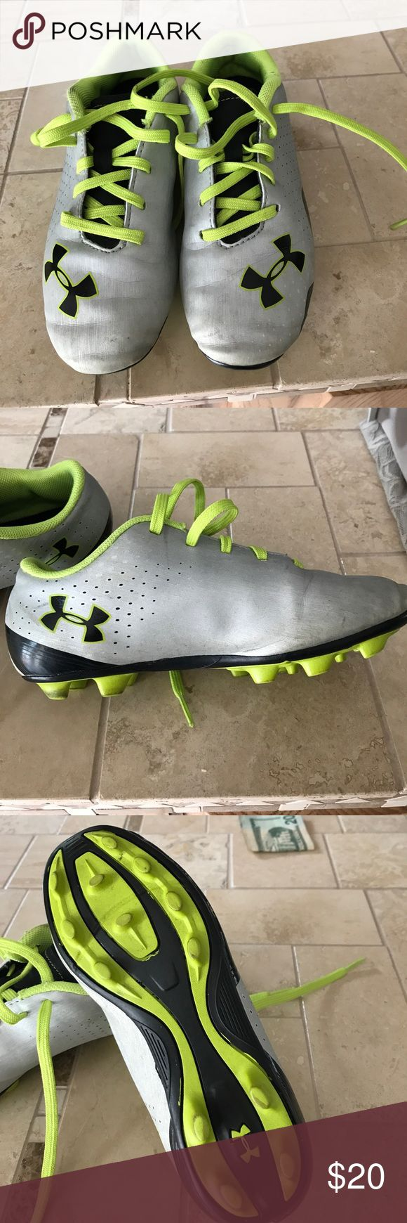 Boys football cleats Boys Under Armour football cleats. Cleats worn for one football season. In good condition but do show some signs of normal wear. No rips or major stains. Boys size 1. Silver and lime green color. Under Armour Shoes Sneakers