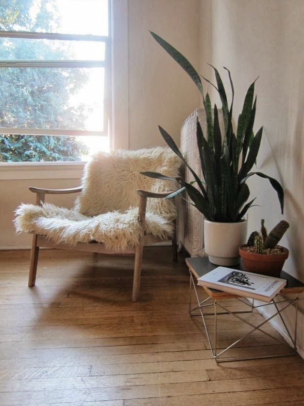 Great sheepskin as chair cover for mid-century scandi chair