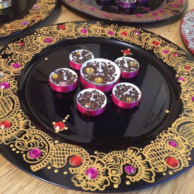 Mehndi thaal decorated with gold paints and gemstones.. #henna #hennaart #mehndi #mehndithaal #mehndiplate #art #artset #hennacandles #hennatealights #mehndidecor #decor #asianweddings #bride #groom #weddingseason