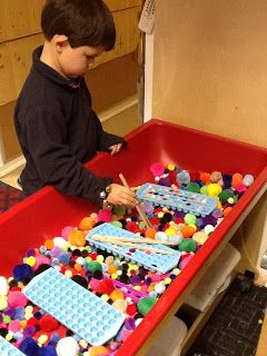 Playfully Learning: Sensory Table Idea-Pom Poms. Great for fine motor skills, math concepts, quiet time. etc.