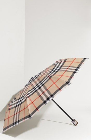Burberry London Compact Umbrella @ #Nordstrom.  Raining season is fast approaching so why not get a new  Burberry Umbrella to replace my old one! :-)