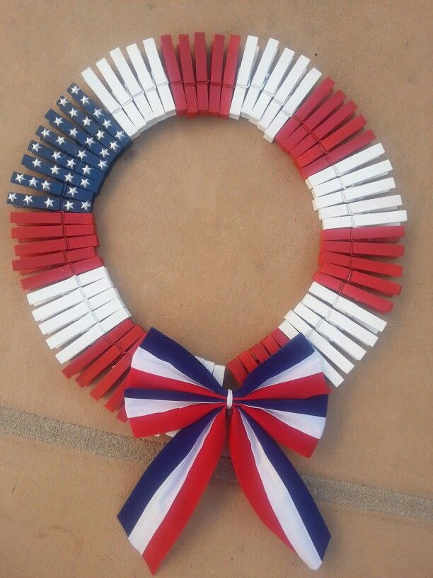 How patriotic! Create this DIY clothes pin flag wreath as a family!