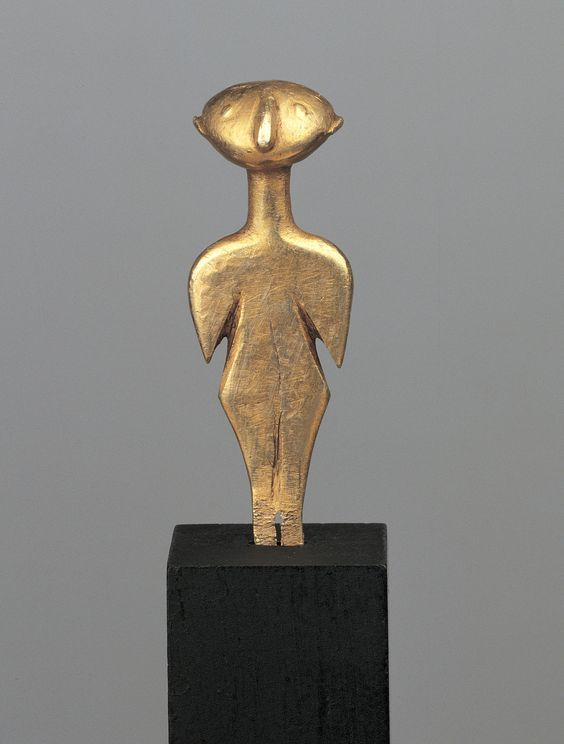 Electrum Kilia type idol, late 4th-3rd millennium B.C. Anatolian. These idols are named after a fi gurine from a site near Gallipoli, in the Chersonese, on the European banks of the Strait of the Dardanelles. Their form is very homogenous,  6 cm to 23 cm, the typology is characterized by a great stability of schema,  contrary to the examples of Cycladic statuettes that are partially contemporary and geographically close to Kilia idols, 4.4 cm high. Private collection
