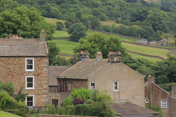 https://flic.kr/p/RbFkzB | Reeth Village (north yorkshire) | www.adamswaine.co.uk  Looking down the Green at Reeth, Swaledale   Reeth lies where two of North Yorkshire's finest dales meet. The most northerly of these is Arkengarthdale, which is relatively unexplored and one of the more tranquil dales. The other, Swaledale, is formed from gentle slopes as the meandering Swale winds its way to Richmond.  Reeth, at the juncture of these two dales, is at the heart of Swaledale. It has a large…