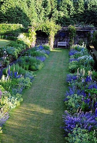 """Looking along the restored double herbaceous border in the garden at High Glanau Manor. The garden was laid out by H. Avray Tipping in the 1920s."" Copyright: Country Life/IPC Media Ltd."