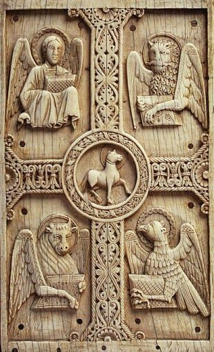 The four gospels surround the lamb of god.