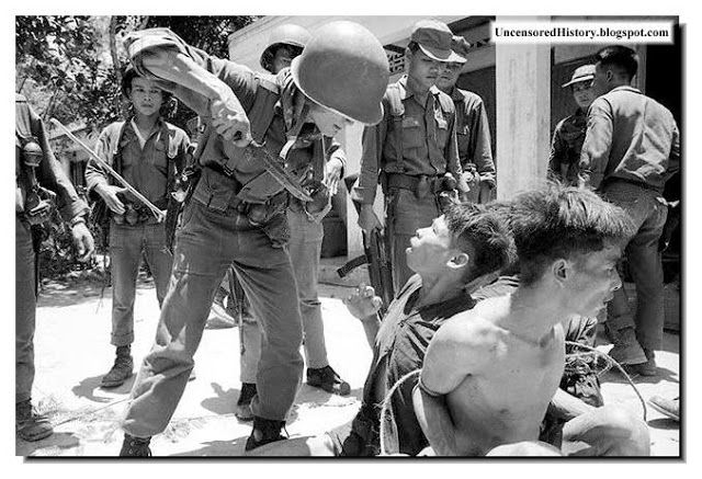 A Arvn Soldiers Uses Third Degree To Extract Information