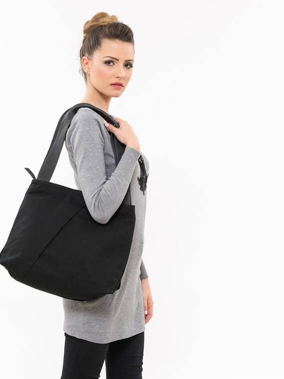 The Benita matt Black large tote bag is beautifully crafted from linen. Its medium/large size is exactly what I need to carry necessities from the beginning of my business day to the end. The Benita Linen shoulder bag is a practical look that wont let you down. This classic work black bag will stand the test of time, and look good for years to come. This is the large black handbag that you will love for its size and its conveniently defined pockets. Bag Specifications: Opening length: 37...