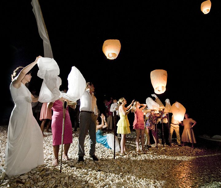 Perfect end to a wedding evening, sky lanterns on the beach www.paxosweddings.co.uk