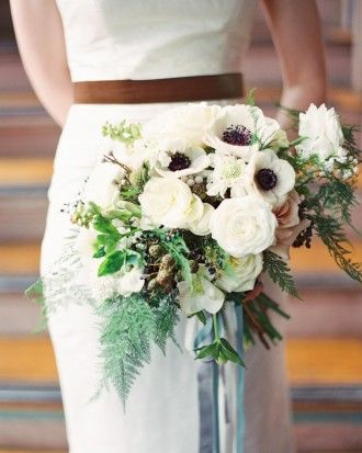"""This bridal bouquet included white garden roses, lisianthus, sweet peas, gardenias, chocolate cosmos, scabiosa, anemones, eucalyptus, dusty miller, brunia, blackberries, and loose greenery. A bluish velvet ribbon (her day's """"something blue"""") blended into the grouping of hand-tied streamers that held her bouquet together. Follow the link to see more images of this real wedding in South Carolina!"""