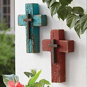 "WOODEN DOUBLE CROSS  _  Hand crafted from recycled barn wood, this rugged cross is painted with a distressed finish and accented with a smaller rustic iron cross in the center. This design is exclusive to King Ranch. Specify Turquoise or Red. 6""w x 1 1/2""d x 9""h. Imported."