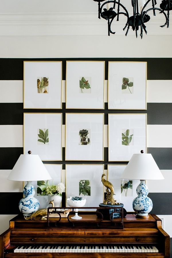 My Most Asked-About Accessories: gallery wall grid of botanical prints, inexpensive frames with gold spray paint, custom mats, piano, blue and white lamps, entryway, foyer, stripes