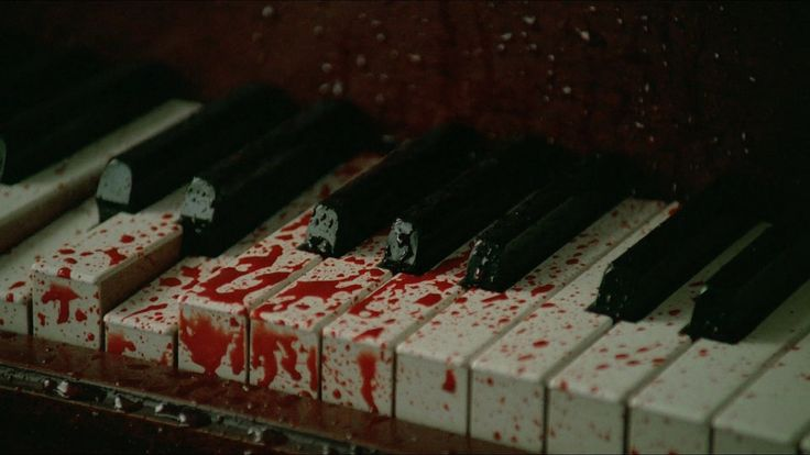 Blood splattered everywhere, turning the ivory keys crimson