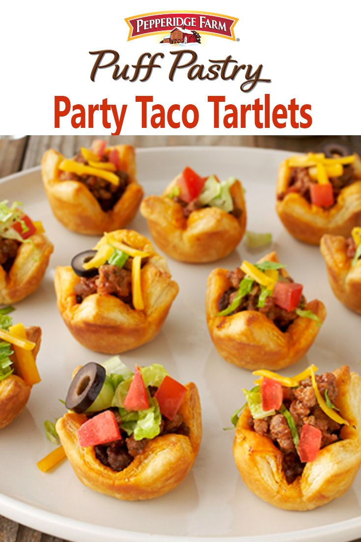"""Puff Pastry Party Taco Tartlets Recipe. Hello, Taco Tuesday! Add some spice to your next party with bite-sized tacos in Puff Pastry tartlets. Finish them with your favorite toppings, or let your guests top their own at a fun """"Fill-Your-Own Taco Bar"""". We filled ours with a classic mix of taco-seasoned ground beef, shredded cheddar cheese, lettuce, tomatoes, and olives. They're also delicious with your favorite taco fillings like shredded chicken, diced avocado, sour cream, cilantro and lime."""