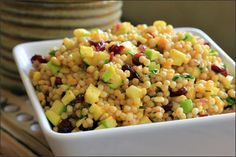 Pearl couscous salad with fresh herbs, green apples, dried cranberries and toasted pine nuts
