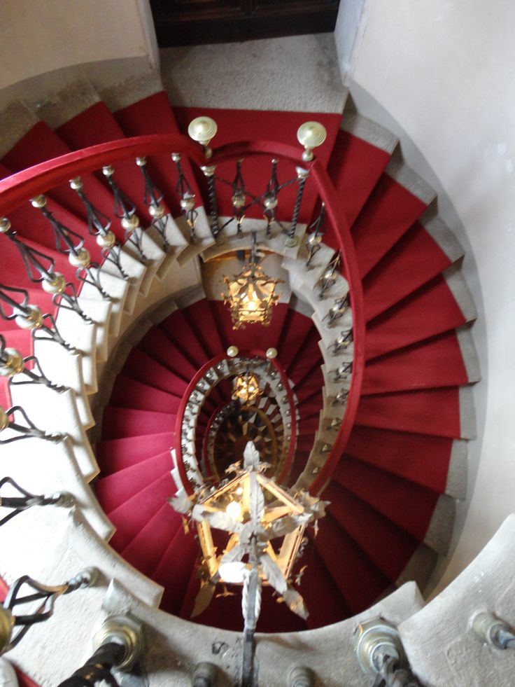 Palladio's Stairs, Castello di Duino, Trieste, Italy metal shaped with large white balls in center of each spindle; red carpeting; looking down several levels