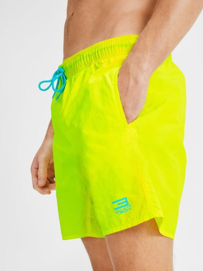Classic swimshorts with inner briefs and pockets, in neon yellow and light blue contrast   JACK & JONES #summer #style #men #swimwear #swim #briefs