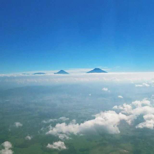Mount Merbabu and Mount Merapi as if they are floating in the sky.