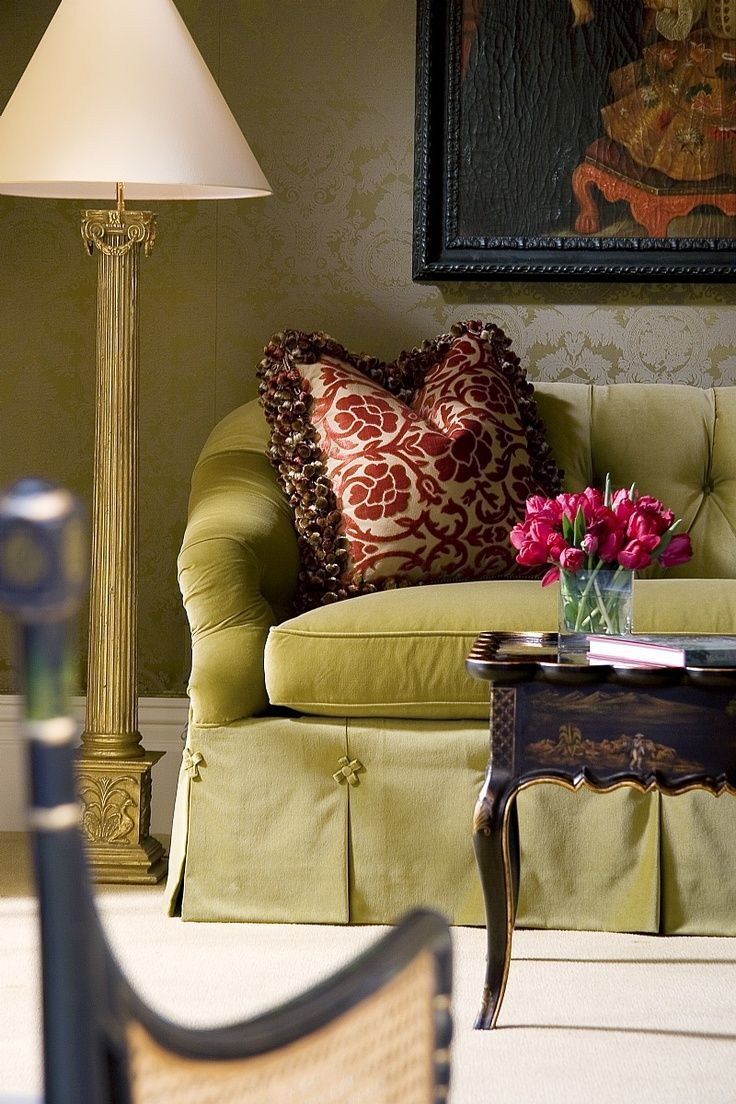 Skirted Moss Green Sofa With Gold Lamp And Pink Pillow Traditional
