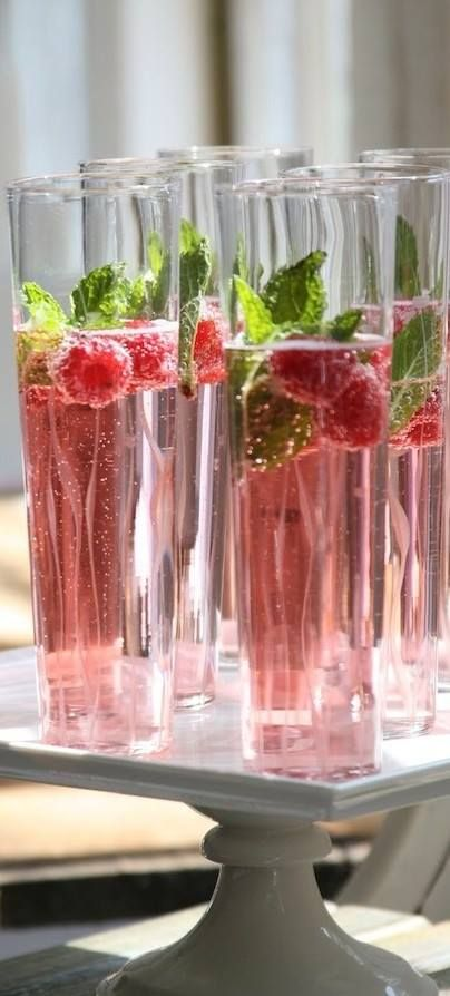 Champagne with cranberry juice and raspberries.