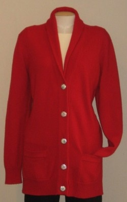 Chanel cashmere cardigan. Vibrant red, button front cardigan. This is a longer, oversized, boyfriend style cardigan. Features novelty buttons, shawl collar & 2 pockets. From Spring 2008. SIZE Medium