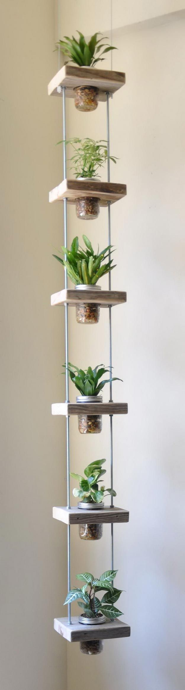 Mason Jar Vertical Herb Garden | How To Grow Your Herbs Indoor - Gardening Tips and Ideas by Pioneer Settler at http://pioneersettler.com/indoor-herb-garden-ideas/