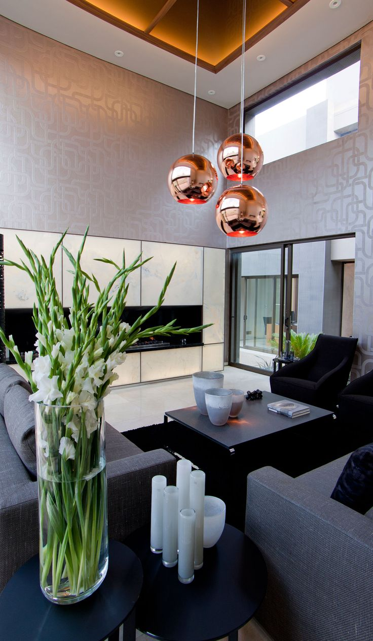 House Sedibe by Nico van der Meulen Architects (10)  - ♥ the hanging copper globes & flower arrangement/vase combo