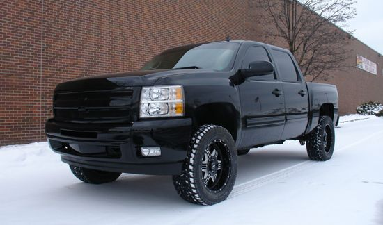 one day i will get a  chevy silverado truck with a lift kit on it, Black on Black. Country boy in me has always wanted one.