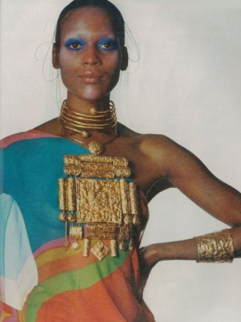 Naomi Sims wears an 18k hammered gold necklace and cuff by Lisa Sotilis, 1971.  Dress by Hanae Mori.