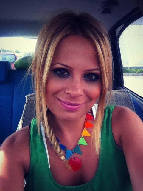 Lena Karagianni & her Bunting Necklace! A party for your neck, celebrate! Adds a little fun to any outfit! Enjoy...