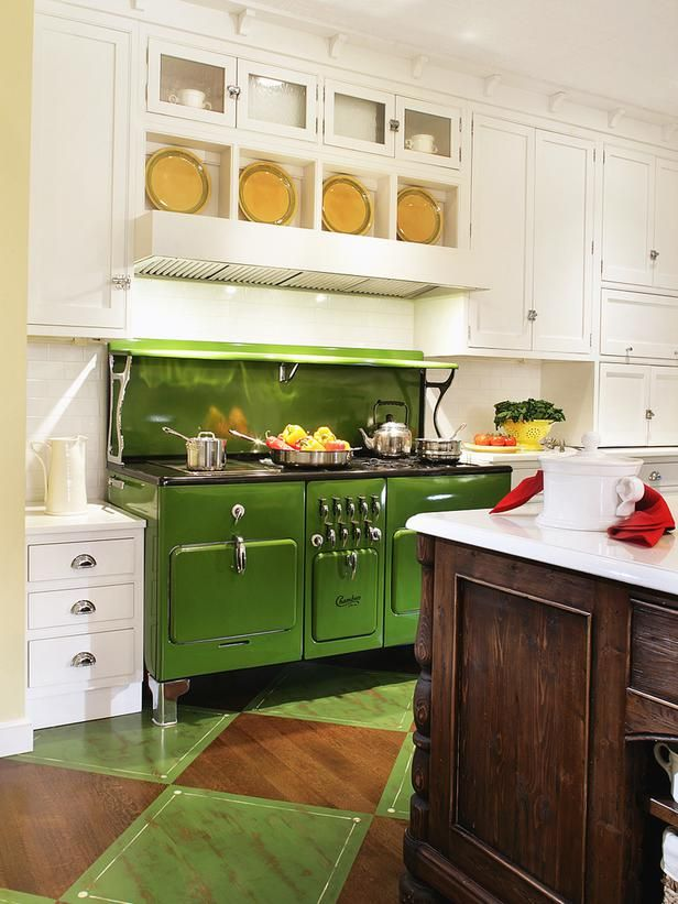 Apple green tends to be used in modern spaces, but a striking apple green stove looks right at home in this vintage-inspired cottage kitchen by Regina Bilotta. When mixed with dark wood and richer tones, it settles down nicely.