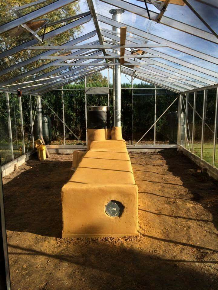 Rocket stove greenhouse - heating with wood in a more energy efficient manner.