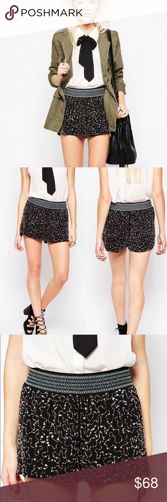 "Raga Embellished Shorts Black Beaded Shorts NWT Raga Embellished Shorts Black Beaded Shorts. Stretch Band Waist, Beautiful Bead Work, Inseam 2.5"", Waist 15"", Hips 21"". Excellent Condition - NWT - No Flaws No Fading. Retail $102.00 #0208170804 ✨Please keep in mind that measurements are provided only as a guide and are approximate.  Color appearance may vary depending on your monitor settings. ASOS Shorts"