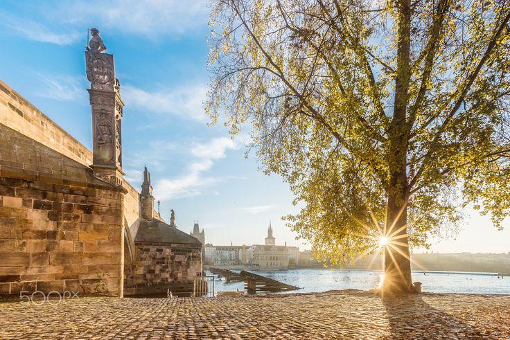 Morning at the river - Sunrise in Prague - Charles bridge on the left.