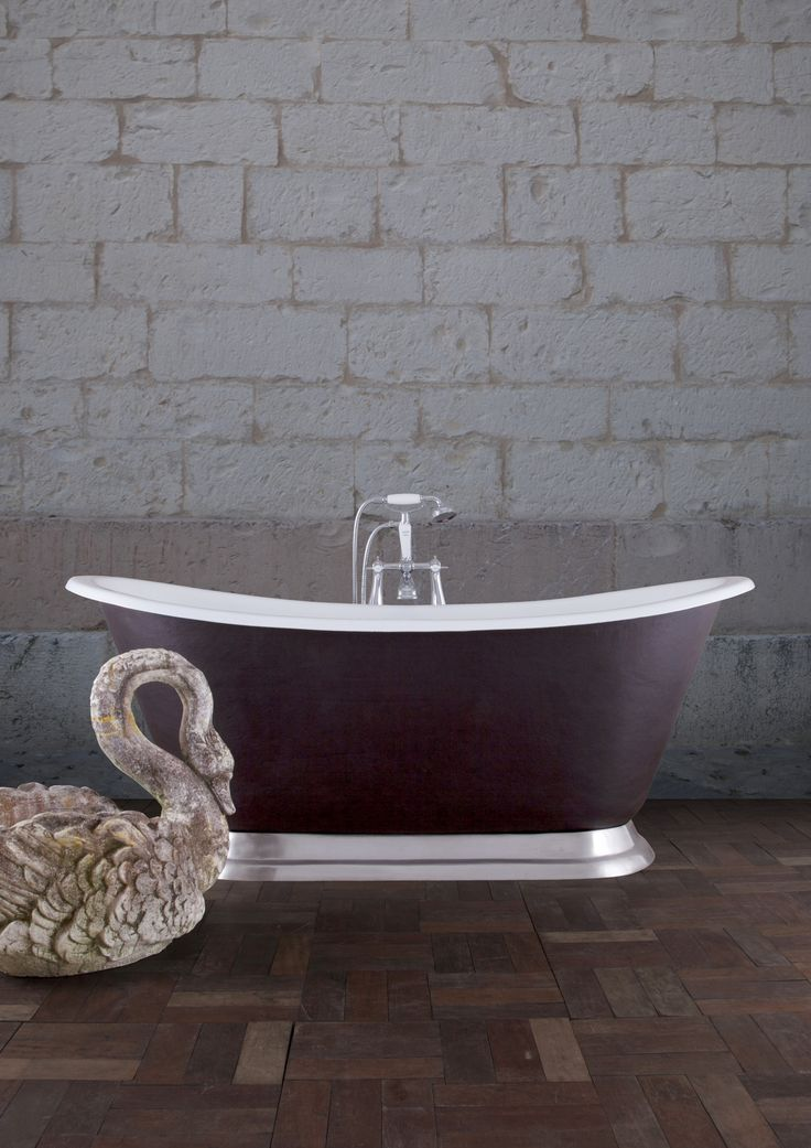 Our stunning Galleon cast iron bath wrapped in Conway leather and finished off with a polished plinth - great for a gothic revival #home #castiron #bath #galleon