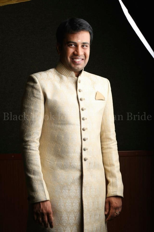 Groom Sivaganesh, keeping it classy in a simple cream and gold sherwani. #IndianWedding #Tamil #IndianGroom