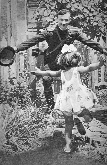 USSR. Soviet soldier returning to greet his daughter, c.1945 WWII