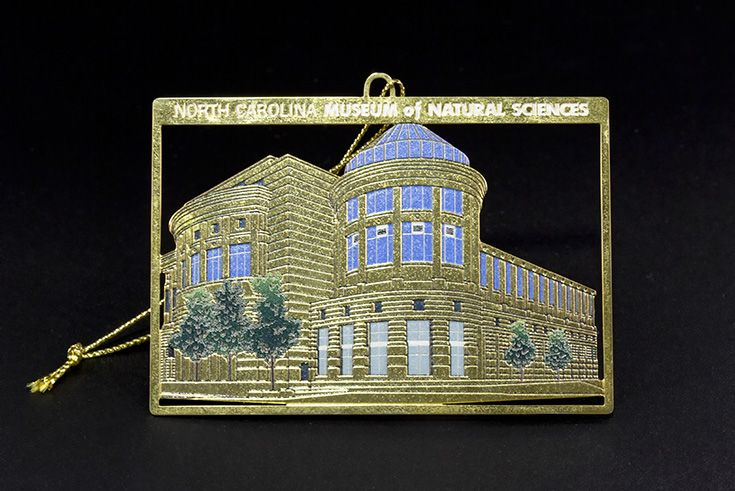 """Museum Ornament. Depiction of the """"Acro Dome"""" and main entrance of the North Carolina Museum of Natural Sciences. $14.95."""