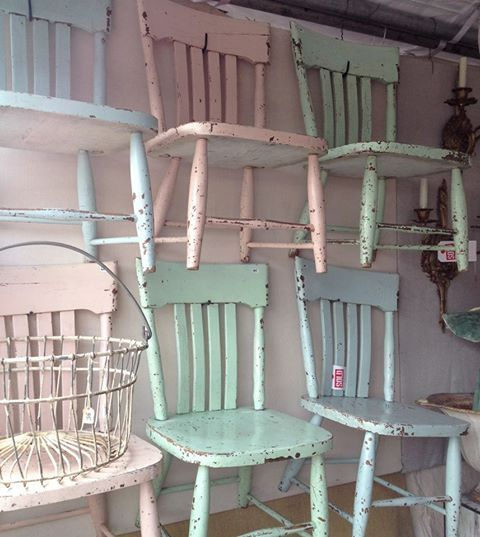 """I should take all the chairs I have hanging on my garage waiting to """"be something,"""" paint them in pastels, and hang them on the walls of my booth!"""