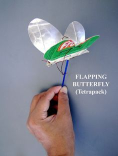 flapping butterfly made w/ cardstock & wire... This looks like a Mike job to me.