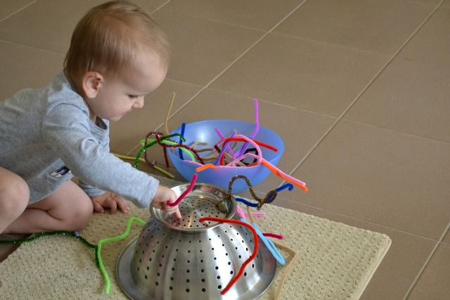 Montessori toddler activities: Threading activity with pipe cleaners and upside-down colander