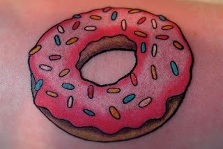 Pink donut tattoo: I've been thinking of this exact idea for a bit for me & my 3 college besties...our SPOT was the little local Dandy Donut shop...this would kinda be a best friend tattoo???!!