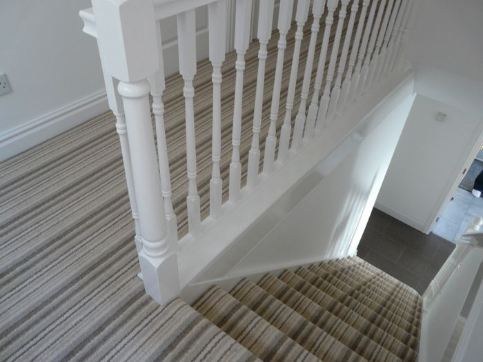 Strip carpet on stairs