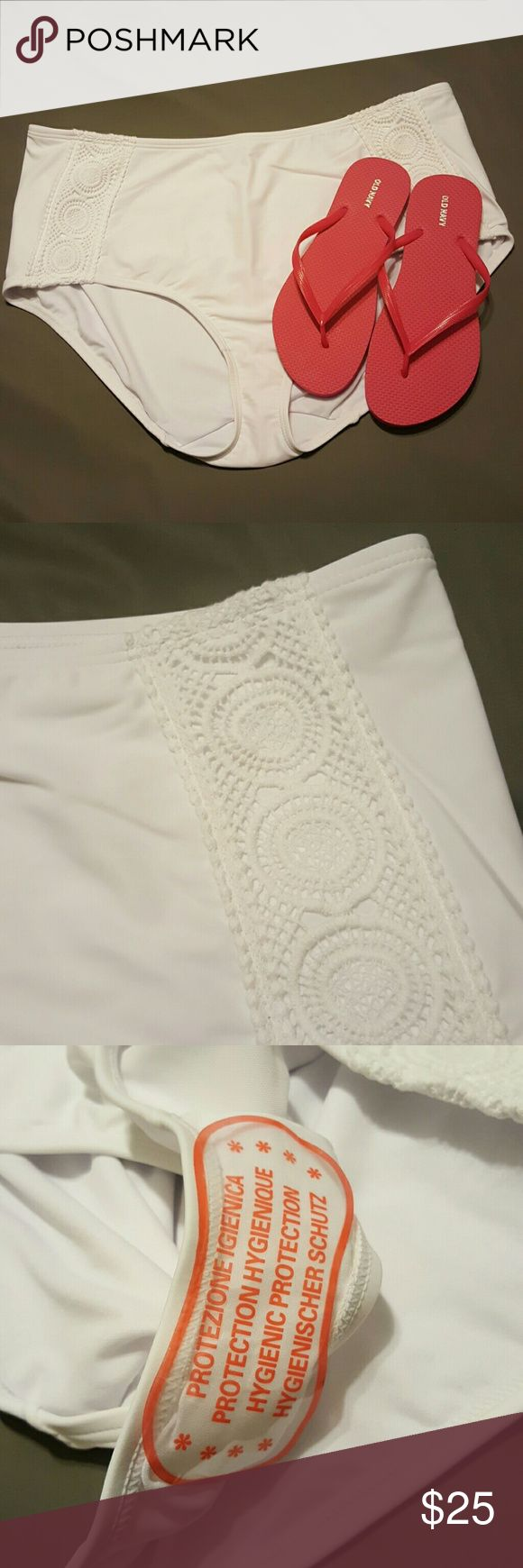 Lane Bryant Cacique White Swim Bottom True white swim brief with soft crocheted detail on both hips. Soft-to-touch but supportive stretchy material - no itchy seams! BNWT, never been worn or even tried on. Plastic manufacturer liner on crotch. Clean, non-smoking home, no pets. Lane Bryant Swim Bikinis